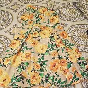 Tan fit and flare dress with yellow rose print